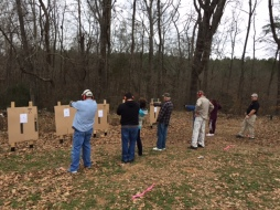 Students practicing aiming down range.